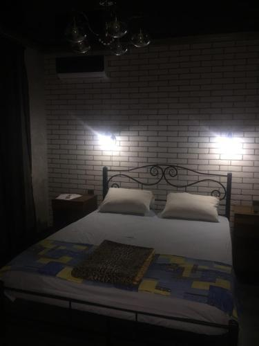 A bed or beds in a room at Guest House Asya