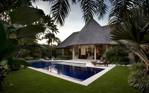 The swimming pool at or near The Kunja Villa-Hotel