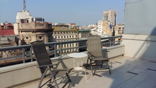 A balcony or terrace at Panorama Studios Old City Center 38