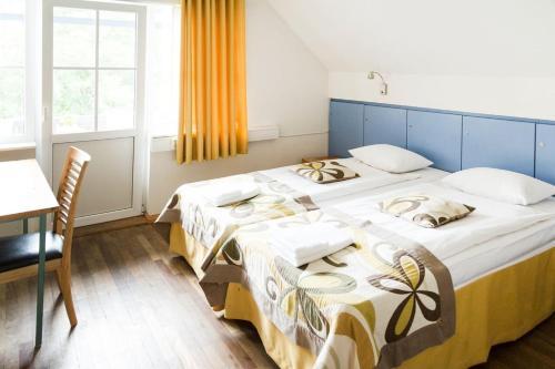 Katil atau katil-katil dalam bilik di Arno Apartments