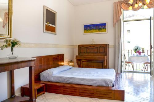 En eller flere senge i et værelse på casa vacanza il nido