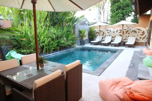 The swimming pool at or near Exquisito Villa