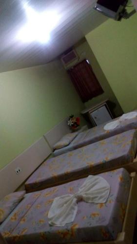 A bed or beds in a room at Pousada Sao Geronimo
