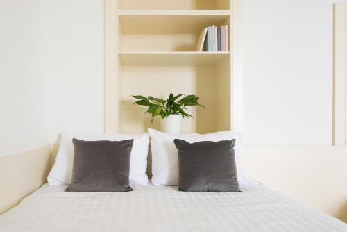 Ein Bett oder Betten in einem Zimmer der Unterkunft myNext - Johannesgasse Apartments