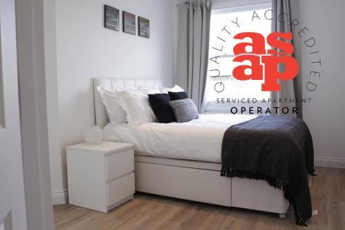Ein Bett oder Betten in einem Zimmer der Unterkunft Urban Stay Notting Hill Apartments