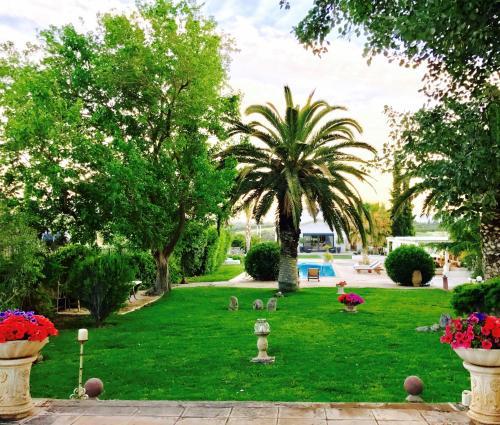 A garden outside Villa Vravrona Tower & Suites