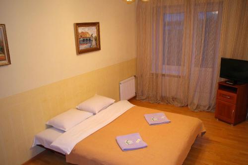 Кровать или кровати в номере Апартаменты Северная Столица
