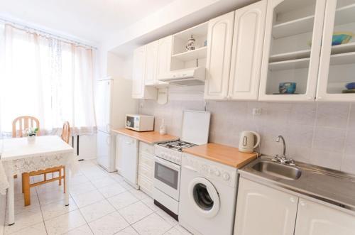 A kitchen or kitchenette at Serviced Apartments Mayakovskaya