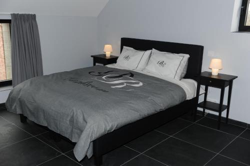 Un ou plusieurs lits dans un hébergement de l'établissement Fenêtres sur cour