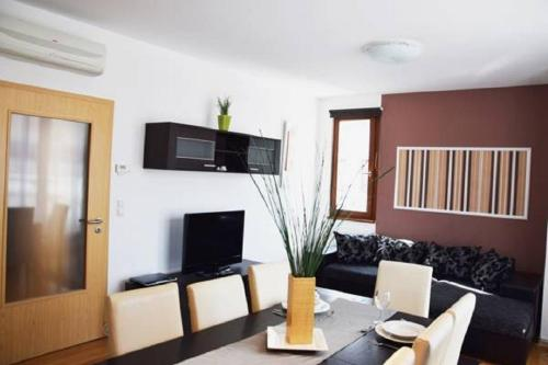 A television and/or entertainment center at Senator Apartments Budapest