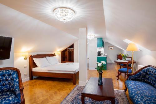 Un ou plusieurs lits dans un hébergement de l'établissement Manesova No.5 Apartments