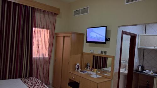 تلفاز و/أو أجهزة ترفيهية في السلام إن للأجنحة الفندقية
