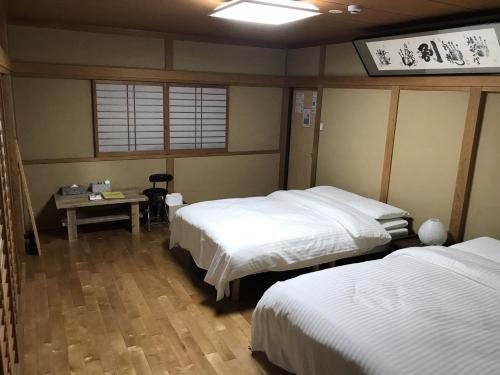 A bed or beds in a room at Hondori Inn