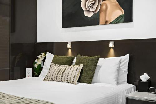 A bed or beds in a room at North Adelaide Boutique Stays Accommodation