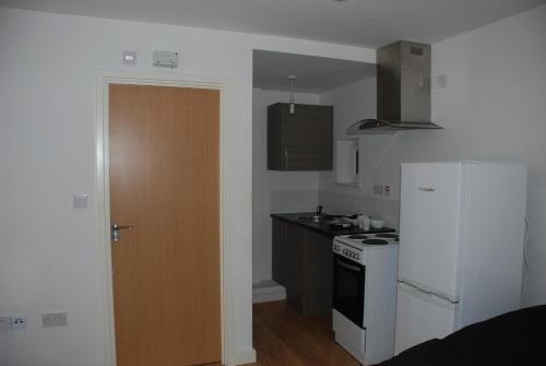 A kitchen or kitchenette at Apartments @ Unity House