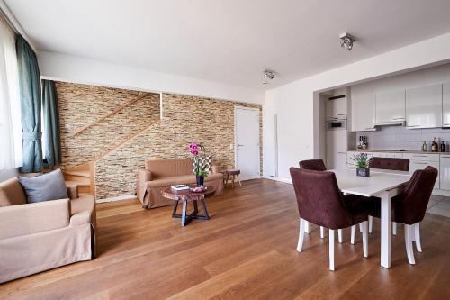 Uma área de estar em Residence Regent 55