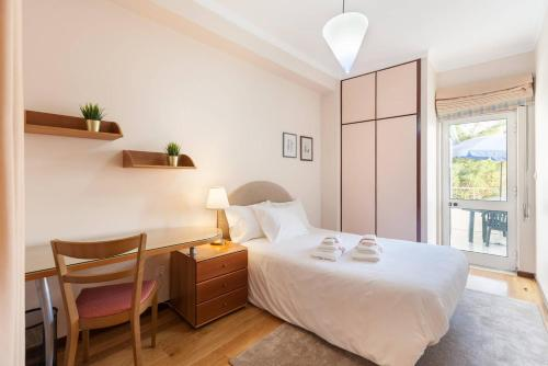 A bed or beds in a room at Charming Apartment in Braga Historical Center - Minho's Guest