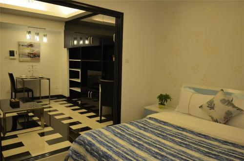 A bed or beds in a room at Xierman Aparthotel Jiaokou Station Branch