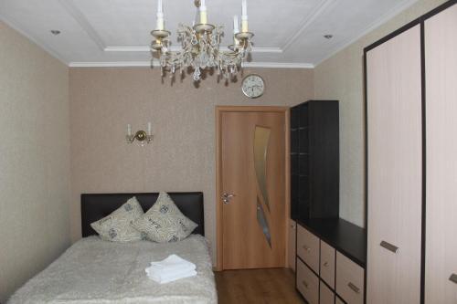 Кровать или кровати в номере Квартира в центре Обводный 9к3