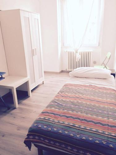 A bed or beds in a room at Rent InSquare