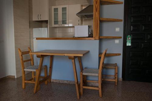 A kitchen or kitchenette at Apartamentos Ripoll Ibiza