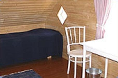 Vuode tai vuoteita majoituspaikassa Ketolantilan Majoitus