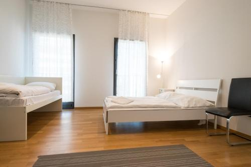 A bed or beds in a room at Downtown Apartments