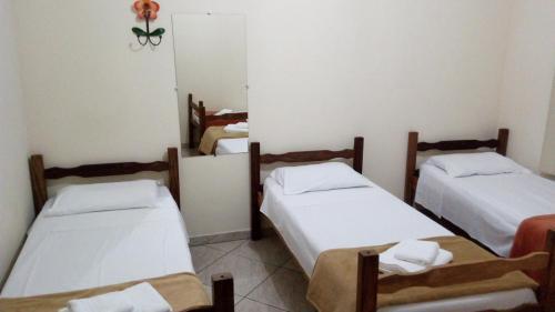 A bed or beds in a room at Casa De Carlos Eduardo