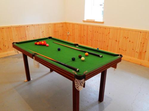 A pool table at Cnoc na Ri Cottage