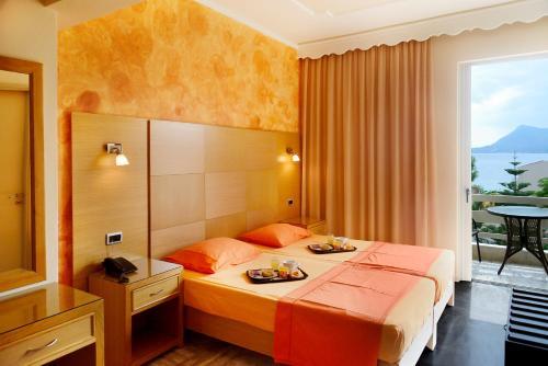 Ένα ή περισσότερα κρεβάτια σε δωμάτιο στο Studios Asteria