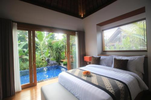 Un ou plusieurs lits dans un hébergement de l'établissement Ume Sri Villas Ubud