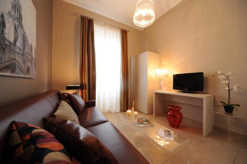 A seating area at Trianon Borgo Pio Aparthotel