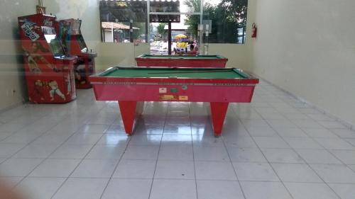 A pool table at Suíte no Thermas Place