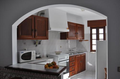 A kitchen or kitchenette at Apartamentos Campos 1