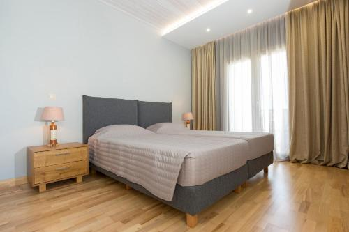 A bed or beds in a room at Virginia Luxury Villas