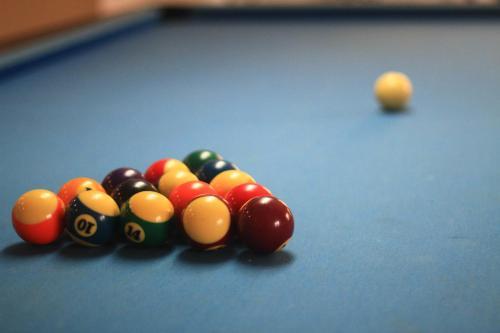 A pool table at Aditya Mansions Apartment