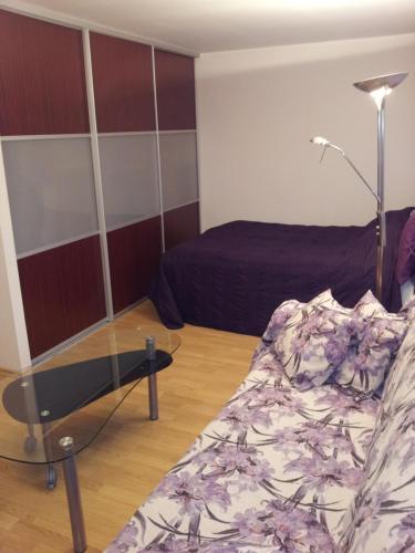 Vuode tai vuoteita majoituspaikassa Astra City Centre Apartment