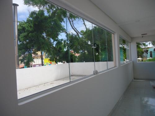 Uma varanda ou terraço em Suites Cheiro do Mar