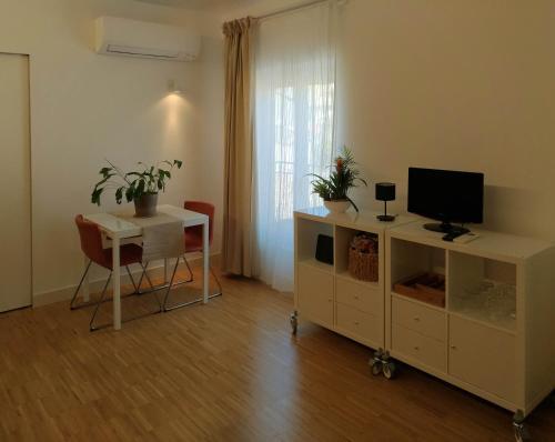 TV o dispositivi per l'intrattenimento presso Elegant Apartment Coronari-Navona