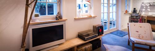A television and/or entertainment center at Joans B&B