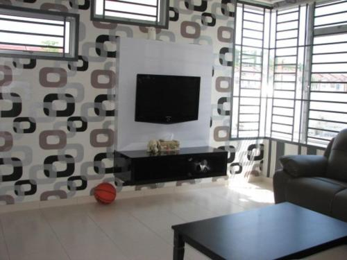 A television and/or entertainment center at Private Jacuzzi swimming pool house