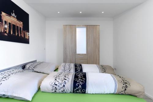Ein Bett oder Betten in einem Zimmer der Unterkunft Luxusapartment nahe Müggelsee