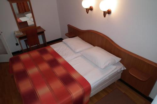 Postel nebo postele na pokoji v ubytování Hotel Napsugar
