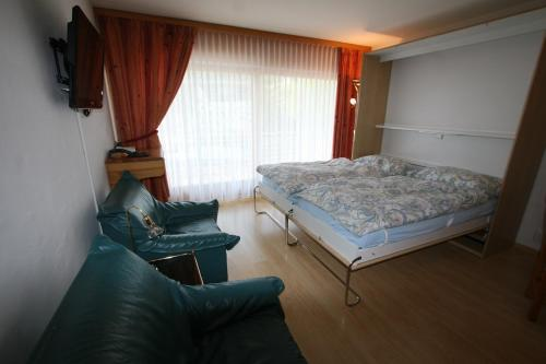 A bed or beds in a room at Résidence Mont-Calme