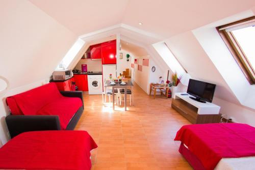 Ein Sitzbereich in der Unterkunft Apartamentos Paseo del Arte