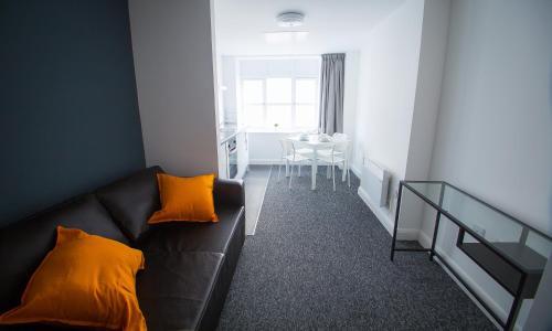 A seating area at L3 Apartments at Fox Street Studios