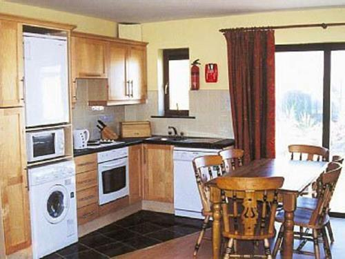 A kitchen or kitchenette at Kinsale Coastal Cottages