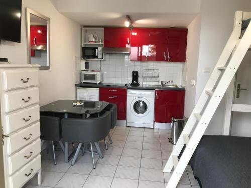 Cuisine ou kitchenette dans l'établissement Residence Acapulco