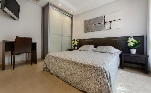 A bed or beds in a room at Apartamentos Benitachell