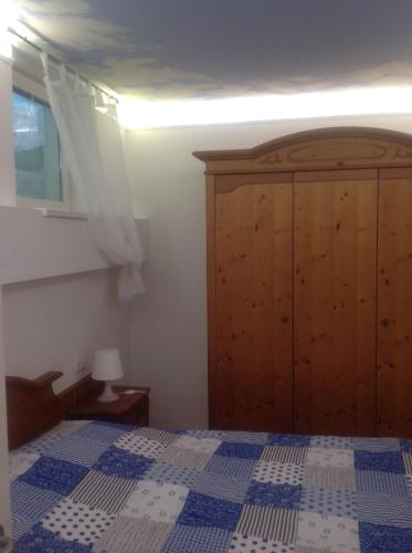 A bed or beds in a room at Haus Lisi